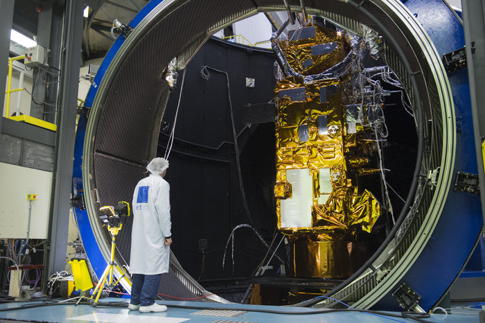 he payload module of MetOp-C, Europe's latest weather satellite, seen through the side door of Europe's largest vacuum chamber, the 10 m-diameter Large Space Simulator, during testing in March 2017.